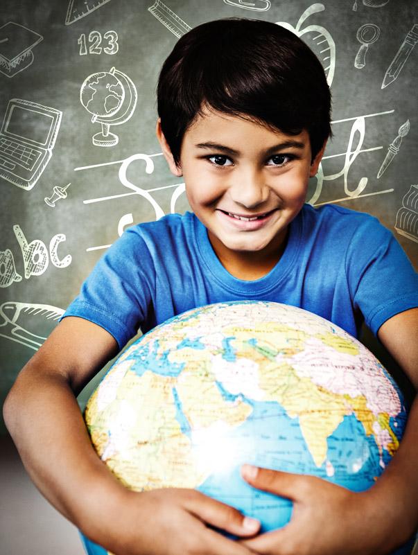 kid holding globe